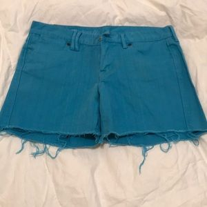 Bright blue Madewell cutoff shorts